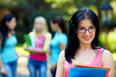 Portrait of female student in glasses outdoors Royalty Free Stock Photography
