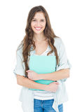 Portrait of female student holding books Stock Image