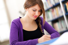Female student in a library Stock Image