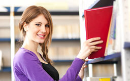 Female student taking a book Stock Images