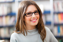 Female student in a library Stock Images