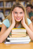 Portrait of female student in library Royalty Free Stock Photos