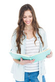 Portrait of female student reading a book Royalty Free Stock Images