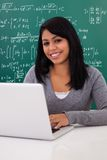 Portrait of female student using laptop Stock Photo