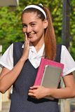 Portrait Of A Female Student Wearing Uniform With Books