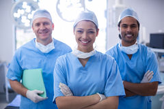 Portrait of female surgeon standing with arms crossed in operation room. At the hospital Royalty Free Stock Photo