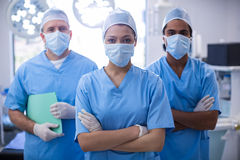 Portrait of female surgeon standing with arms crossed in operation room. At the hospital Royalty Free Stock Photography
