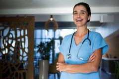 Portrait of female surgeon standing in hospital Stock Photo