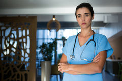 Portrait of female surgeon standing in hospital Royalty Free Stock Image
