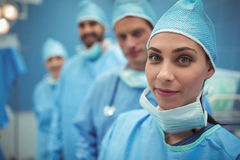 Portrait of female surgeon standing in operation theater Stock Photography
