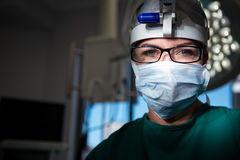 Portrait of female surgeon wearing surgical mask Stock Image