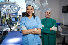 Portrait of a female surgeons standing in operation theater Stock Image