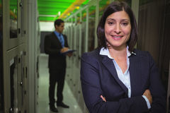 Portrait of female technician standing with arms crossed. In server room Royalty Free Stock Photos