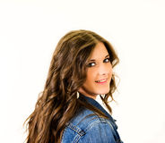 Portrait Female Teen Close Up. Young girl blue jean jacket long hair Royalty Free Stock Image