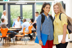 Portrait Of Female Teenage Students In Classroom Stock Photos