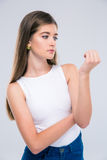 Portrait of a female teenager looking at her nails Royalty Free Stock Photo