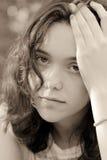Portrait of female teenager sad stock photo