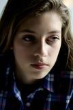 Portrait of female teenager thinking Royalty Free Stock Image