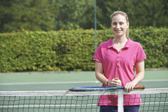 Portrait Of Female Tennis Coach On Court Royalty Free Stock Photos