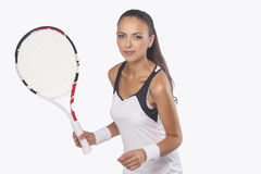 Portrait of Female Tennis Player Preparing to Serve Royalty Free Stock Image