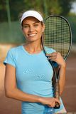 Portrait of female tennis player smiling Royalty Free Stock Image