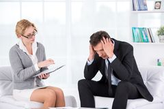 Portrait of female therapist in office with her Stock Image