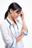 Portrait of a female tired doctor Royalty Free Stock Photos