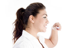 Portrait of female with toothbrush Stock Image