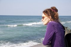 Portrait of a female tourist on a blurred sea background royalty free stock photo