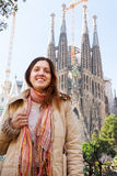Female tourist in front of Sagrada Familia Royalty Free Stock Photos