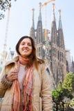 Female tourist in front of Sagrada Familia. Portrait of female tourist in front of Sagrada Familia in winter royalty free stock photos