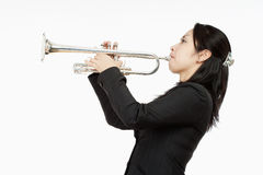 Portrait of a Female Trumpet Player. Isolated on White Royalty Free Stock Images