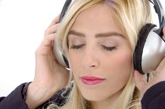 Portrait of female tuned in music Royalty Free Stock Image