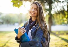 Portrait of female university student outdoors on campus Royalty Free Stock Photos