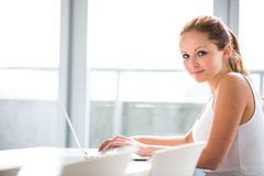 Portrait of a female university studentusing laptop Royalty Free Stock Photography