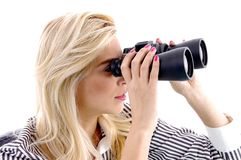 Portrait of female watching through binocular Royalty Free Stock Photos