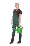 Portrait Of A Female Worker Holding Watering Can Royalty Free Stock Image