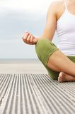 Portrait of female yoga hands at beach Stock Images