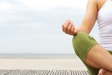 Portrait of female yoga hands at the beach Royalty Free Stock Images