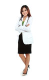 Portrait of female young doctor standing with folded arms Royalty Free Stock Image
