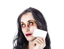 Zombie with business card. Portrait of female zombie with business card, bad branding concept on white background Stock Image