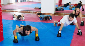 Portrait of females and males training in boxing gloves royalty free stock photos