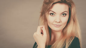 Portrait of feminine blonde young woman Royalty Free Stock Image