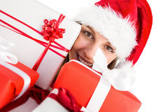 Portrait of a festive young woman holding many gifts Stock Photography