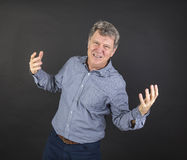 Portrait of fifty year old man showing emotions Royalty Free Stock Photos