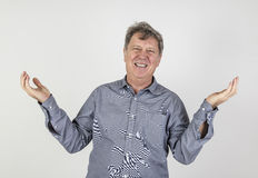 Portrait of fifty year old man showing emotions Royalty Free Stock Images