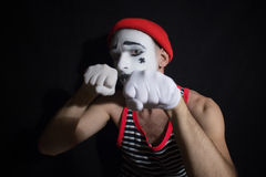 Portrait of fighting mime Stock Photo