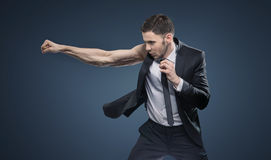 Portrait of the fighting muscular businessman Royalty Free Stock Photos