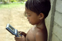 Portrait of Filipino child playing with gameboy Royalty Free Stock Image