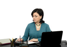 Portrait of financial planner working online. Portrait of black haired attractive businesswoman working with laptop an online financial adviser Stock Photo